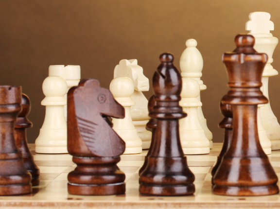 Closeup wooden chess game - sales training metaphor
