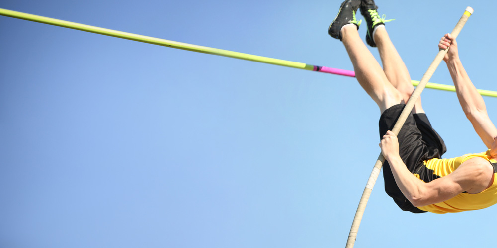 Male pole vault athlete