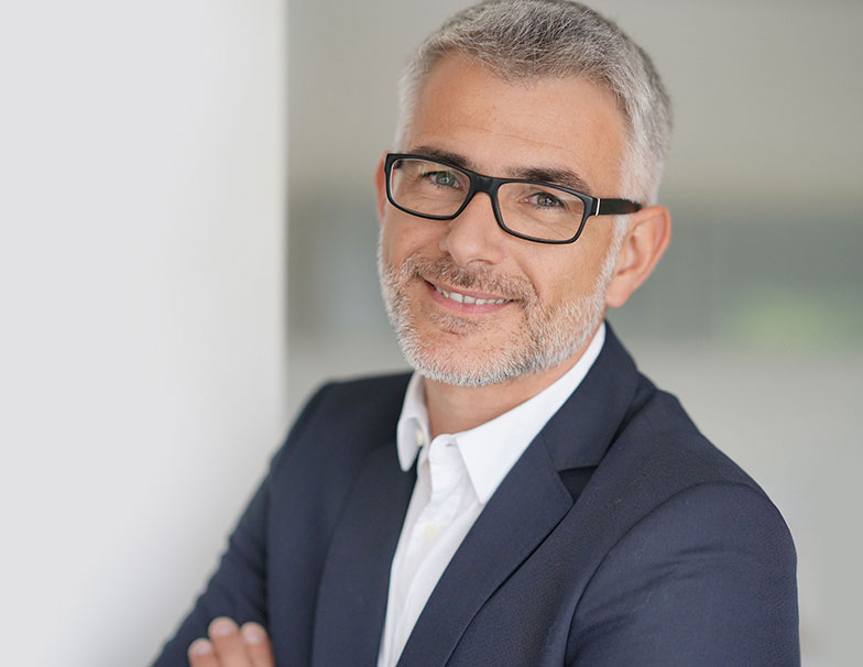Sales manager with glasses smiling